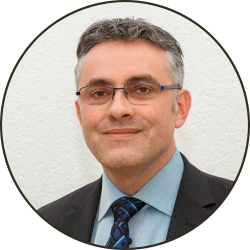 Portrait picture of Stéphane Gumy, General Manager and Senior Consultant